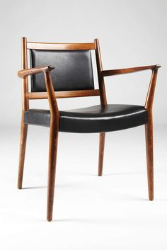Very close to the design of a chair I bought at the swap meet a few weeks ago. Steffan Larsen: Rosewood and Leather Armhair, 1960s