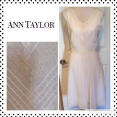 Ann Taylor Embroidered White Shift Dress Size 4 A portion of my sales goes to dog rescue.    Size 4 Ann Taylor dress is beautifully embellished with embroidery around the bodice & at the hemline. Fully lined & has buttons to hold your bra straps in place. So feminine. I had a tear repaired where the chest area meets at a V. (See last photo.) The inside lining is torn in 3/4 in area where the outer tear was repaired; however, it's not noticeable on outside of dress.) This is reflected in…