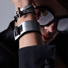 Statement jewelry featuring the Metallic Triple Wrap T Bracelet and Metallic Turnlock Cuff. #TOMFORD