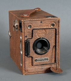 https://flic.kr/p/7APSr7 | Ensign Brand Camera | Found in my parents possessions after their deaths some years ago now. Perfect working order 120 size camera. Outside is a faux hide finish and body is made of wood.  Has anybody heard of Harringtons Ltd (see name plate on front)? I ran a roll of 120 film through it  about 13 years ago. Very cute lens cap.