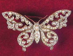 WINGS OF PEARL (Victorian Jewelry By the 1880's Victorian society was beginning to change.  This exquisite Victorian Butterfly brooch is a perfect example of that transitional period. (1880-1890) Set with a multitude of tiny pearls in 14KT gold, you can just picture it landing on ivory lace.