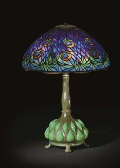"""Tiffany Studios, New York, Favrile Leaded Glass and Patinated Bronze """"Peacock"""" Lamp."""