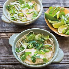 Chicken, vegetables and rice noodles are cooked in a clear, spice-infused broth.