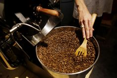 Nate Young stirs a batch of freshly roasted coffee beans that King State Coffee will package for shipment to clients locally and nationally. Young, formerly the drummer for Anberlin, and Tim McTague, guitarist for Underoath, own King State Coffee, a small-batch roaster operating from McTague's home in Lutz that over the last year has become a leader in Tampa Bay's growing craft coffee scene.