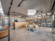 Shelves on right, grey on grey ceiling and floor and walls Pharmacy Design Shoe Store Design, Retail Store Design, Retail Shop, Retail Displays, Deco Spa, Pharmacy Store, Pharmacy Humor, Souvenir Store, Retail Space