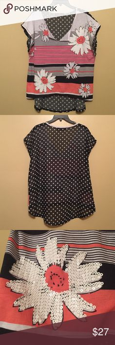 """Spectacular Almost Famous top❣️❣️💋💋💖 This top is so different and unique it caught my eye instantly! Because of it being so beautifully """"odd"""" I had to try it on & there's no words--looks so good on! I promise u will get lots of looks & great compliments. The back is longer and sheer black w white polka dots. Front is soft, not sheer, low vneck. Black and white also but striped, red stripes & coral. 2 large flowers on front are surrounded by white sequins. Worn a few times still great…"""