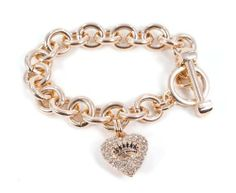 Juicy Couture Rose Gold Starter Charm Pave Heart Icon Crown Bracelet Juicy Couture. $56.99. Pave rhinestones on rose gold tone heart with signature crown logo. H: in x W: in x L: in. Toggle closure. 7.5 inches long. Color: Rose Gold / Gold Hardware