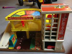 vintage 70's fisher price car parking garage toy - we had one. My favorite part was the car elevator.