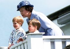 The Queen and grandsons Prince William and Harry look over the balcony at Polo on June 14, 1987.