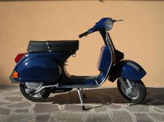 Piaggio Vespa 125 Arcobaleno, the best when I was sixteen. This is the same as I had.
