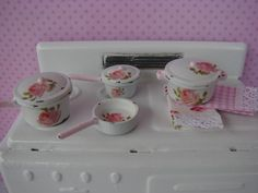Dollhouse Miniature Shabby Chic Set of Pots and Pans Pink Klein Roses. $24.95, via Etsy.