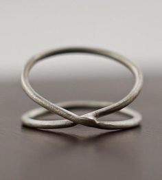 Spiral Sterling Silver Ring | Simple yet elegant, this sterling silver ring has an interesti... | Rings