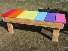 Rainbow bench in daycare play yard #playhousesforoutside #daycarebusiness