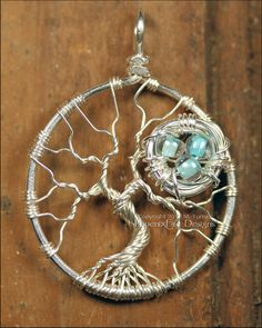 Two of my favorite wire wrapping projects in one! Bird Nest and Tree of Life Pendant Sterling Silver Wire. From Phoenix Fire Designs. Wire Wrapped Jewelry, Wire Jewelry, Jewelry Crafts, Jewelery, Handmade Jewelry, Wiccan Jewelry, Handmade Wire, Tree Of Life Jewelry, Tree Of Life Pendant