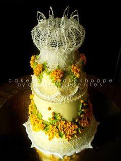 a three tier buttercream covered dark choco-coffee hazelnut cake decorated in lambeth and Australian stringwork details,