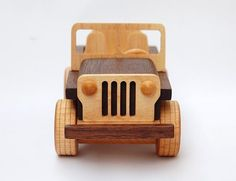 "This toy jeep bears an unmistakable resemblance of classic Willys Jeeps. The most noticeable is the famous Jeep's grille, which is made of 4 parallel grooves carved through thin white maple in front of the dark walnut engine hood. Along with 4 wide, treaded wheels and open seats, it is ready for some serious playing adventures or just sitting pretty on a desk or shelf. This is a meticulously designed and precisely crafted toy with a lot of attention paid throughout into its small 6"" by 3"" by…"