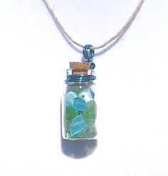 Miniature Glass Apothecary Vial Necklace Blue Green  Glass Bead Chips. $12.00, via Etsy waveoflife