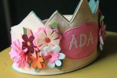 birthday crown. love how many flowers there are! and the blue lining. :)
