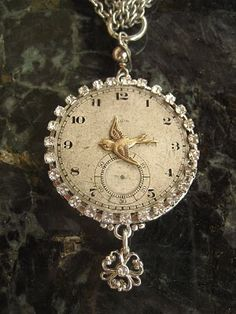 A Mimi-Toria's Design Trademark necklace... pocket watch faces adorned with sparrows and/or rhinestone edging.  This one from 2009 era.