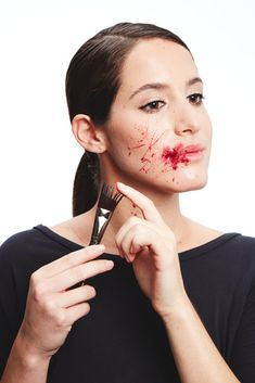 """For a real American Psycho flourish, splatter the blood with a stiff brush like Make Up For Ever Angled Artistic Brush 404 . Dip the ends into """"blood,"""" and run your fingers over the bristles to get a random spray of red."""