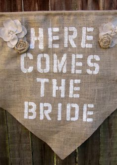 """Make your own """"Here Comes The Bride"""" Banner with burlap, stencils, and fabric paint for the flower girl to carry."""