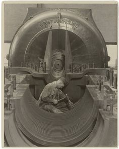 """""""Mechanic in his Shrine. The heart of the Turbine Power House, Penn. R.R."""" By Lewis Hine, New York City, New York, 1924 During the 1920s and early 1930s, photographer Lewis Hine made a series of """"Work Portraits"""" that emphasized the human contribution to modern industry. The skilled workers in these photographs were pictured as active and creative craftsmen whose satisfying labor contributed to the advancement of society."""