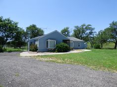 #Auction - Aug. 5th @ 12:00 PM - 1121 E. 55TH ST. S. WICHITA, KS 67216 - Beautiful 3-Bedroom, 2-Bath ranch home on 4.87 acres. From the entry, there's a living room with high ceilings, recessed lighting and large bay windows. The kitchen has lots of cabinetry, an eating bar, and is open to the dining area for entertaining ease. The dining area is open to another sitting area with a nice view to the back. Huge master bedroom has a high ceiling and plenty of space for your entire bedroom…