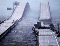 Interstate-10 bridge across Escambia Bay, Florida, after Hurricane Ivan photo looking east from Pensacola at dawn September 16, 2004. (Pensacola News Journal photo)