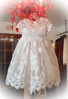 This ivory color exquisite Heiriloom Christening gown is made of the finest Chanitlly lace.This most elegant gown features a pink tulle with