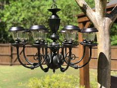 DIY Solar Chandelier - The Shabby Tree #MiniSolarLightsForCrafts Solar Chandelier Outdoor, Solar Lanterns, Chandelier Lighting, Outdoor Lamps, Chandeliers, Diy Solar, Solar Light Crafts, Mason Jar Light Fixture, Light Fixtures