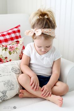 little girl wearing knotted headband
