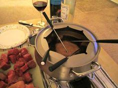 Coq Au Vin Fondue - dippers: shrimp, chicken, filet, potatoes, mushrooms, squash