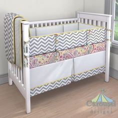 Crib bedding in White Minky Chenille, White and Gray Zig Zag, Solid Banana, Watercolor Paisley, Solid Antique White, Teal Flower Garden. Created using the Nursery Designer® by Carousel Designs where you mix and match from hundreds of fabrics to create your own unique baby bedding. #carouseldesigns