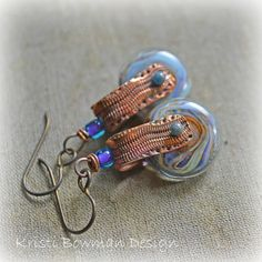 Handmade Smokes Swivel Earrings. $49.00, via Etsy. by KristiBowmanDesign, Lampwork beads by Donna Millard