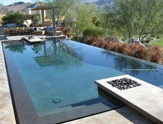 Zero Edge Pool | gorgeous zero edge pool, and I love the modern pergola