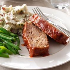 "Sweet and Sour Meat Loaf - ""My husband, Bob, and I like basic, hearty meat-and-potatoes meals. This old family favorite really fits the bill…and does so often. Its sweet/sour flavor adds a deliciously different twist to this longtime standby! I hardly ever make ""plain"" meat loaf anymore. You may not, either, once you've taste this one."" —Debbie Haneke, Stafford, Kansas"