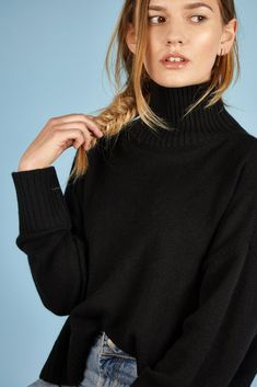 Riley Cashmere Black Roll Neck - soft, comfy and 100% cashmere. Slightly oversize, relaxed fit and cropped at the front, so you can wear it with classy mid-length skirts to tucked in with boyfriend jeans