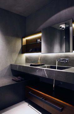 LIKES dark marble sink vanity + cement walls. wall faucets. lighting under medicine cab.  GARIZIO http://www.fabiofantolino.com/it/#progetti
