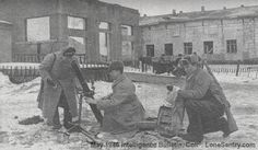 [Members of a battalion medium mortar company set up an M1941 82-mm mortar among the ruins of Kharkov.]