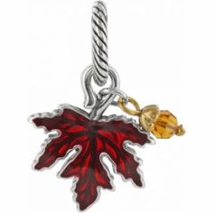 "Brighton! Maple Leaf Charm Let the leaves turn and fall from a bracelet. This red enameled maple leaf charm gets a crystal desdrop to complete the autumn scene.    W: 3/4"" x H: 7/8""  Finish: Brushed gold"