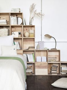 Use storage cubicle boxes or apple crates stacked behind a bed for storage in a small bedroom. Makes a great rustic looking headboard too!