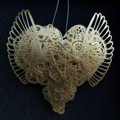 "The heart is such a complicated thing, both physically as it beats to keep us alive, and emotionally in matters of love. These complex pieces are symbolic of the intricate structure and layers of delicate balance associated with a heart. Developed by designer Frank Tjepkema, or Tjep., the two bodies of work, Clockwork Love Gold and Clockwork Love Paper, are described as ""A jewelry collection evenly and consistently combining a great multitude of graphic elements in a multitude of layers."""