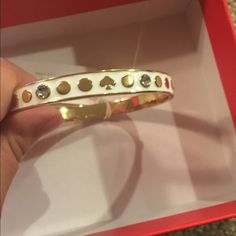 Kate Spade Bangle New Kate Spade Bangle Includes dust bag, gift box, and Kate spade shopping bag. Color: White/Gold Price is firm. No free shipping. No trades kate spade Jewelry Bracelets