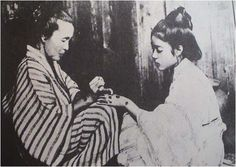 Figure 6. Photograph from 1919 of a young woman being tattooed with Okinawan hajichi, a practice outlawed in 1899. Source: Saito Takushi, Irezumi bokufu: Naze irezumi to ikiru ka,Yokohama: Shunpu sha, 2005, p.174.[21]