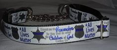 """This striking All Lives Matter is made as an adjustable martingale and will fit neck sizes from 15"""" to 22"""". With gold and blue foil trim, the collar glistens and is sure to catch attention. Backed with black nylon webbing for durability.     This collar can also be made as a flat buckle, martingale or grab handle. Simply email order@allpawsitive.com or message us here and we will create exactly the collar you are looking for! 