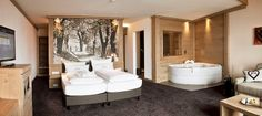 Panoramahotel Oberjoch is probably the most beautiful hotel in Bad Hindelang ✓ Spa ✓ Romantic ✓ 4 star ▻ Price Comparison > Save up to Spa Hotel, Beautiful Hotels, Corner Bathtub, Apothecary, Modern, Relax, Bed, Interior, Places