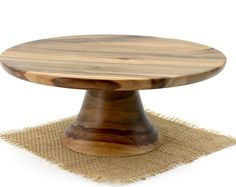 Our new modern cake stand, with sleeker, straighter lines. This unique and one-of-a-kind cake stand is special made to enhance any cake or dessert for generations to come. Would make a great gift for the foodie or baker in your life. Made entirely of salvage or down trees. None are exactly the same, and any slight imperfections are an affect of the handmade quality.  THIS STAND IS HAND TURNED ON A WOOD LATHE, FROM ONE PIECE OF WOOD, NO GLUE OR SCREWS.  PLEASE DO NOT SOAK IN WATER OR PUT IN A…