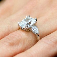 Cushion cut with two pear side stones I have never seen anything more perfect. Love!!!!!!!!!