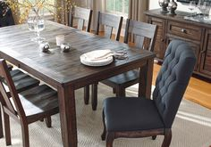 <b>Trudell Dining Room Extension Table</b> <br> Crafted of 100% quality pine wood for years of satisfaction, the Trudell dining room extension table truly is a statement piece. Its distinctive finish with dramatic golden-brown contrasting and subtle wire brush distressing takes the Trudell dining room table from simple to simply extraordinary. <br><br><em>Other items pictured in the image are sold separately.</em>