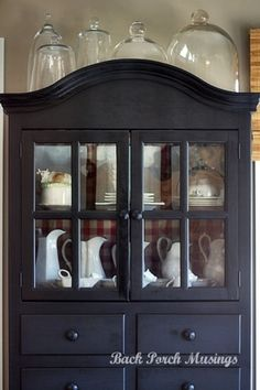 lovely black hutch with red buffalo check behind the shelves